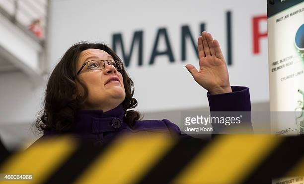 German Minister of Work and Social Issues Andrea Nahles visits the production at the MAN Diesel and Turbo factory on March 13 2015 in Augsburg...