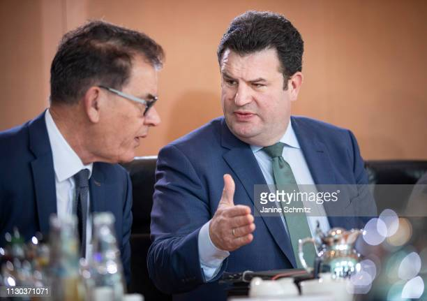 German Minister of Work and Social Issues Hubertus Heil and German Development Minister Gerd Mueller during a conversation before the weekly German...
