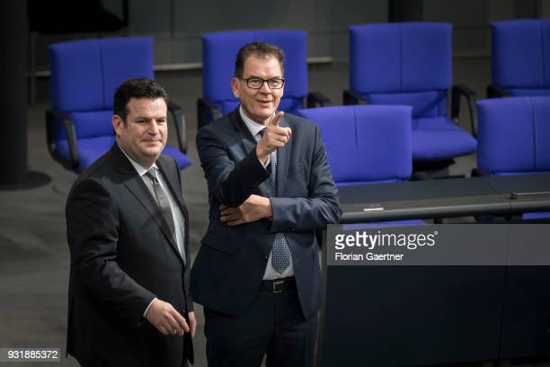 German Minister of Work and Social Issues Hubertus Heil and German Development Minister Gerd Mueller talk before the swearingin ceremony of the new...