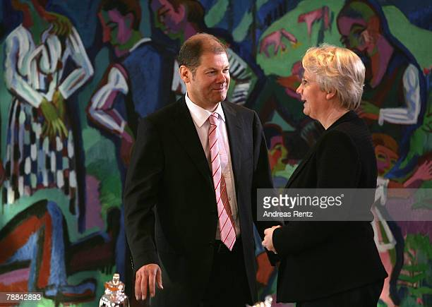 German minister of Work and Social Issues Olaf Scholz talks to German Education Minister Annette Schavan during the weekly German cabinet meeting on...