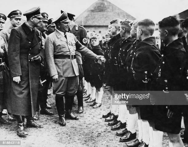 German minister Robert Ley head of the German Labour Front talking to a group of boys after the opening of the Hitler Youth School at Kressinsee...