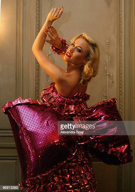 German model Alena Gerber poses for photographers during the presentation of chocolate dresses designed by German bakery group Lambertz on January 21...