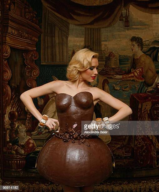 German model Alena Gerber poses wearing a full chocolate dress during the presentation of chocolate dresses designed by German bakery group Lambertz...