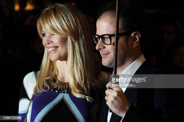 German model and actor Claudia Schiffer and British producer Matthew Vaughn arrive for the European premiere of the film 'Kick-Ass' in London on...