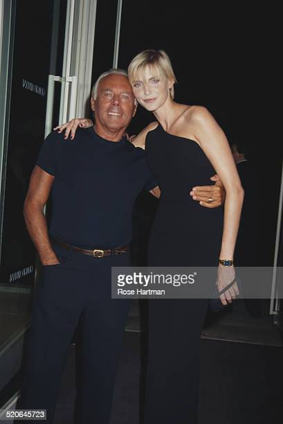 German model and actress Nadja Auermann and Italian fashion designer Giorgio Armani at the opening of the Armani store in New York City USA 1996