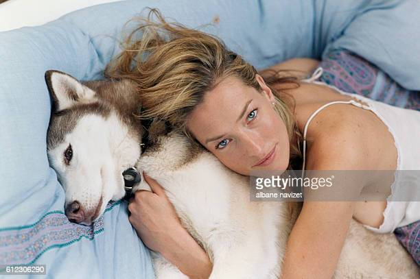 German model and actress Tatjana Patitz at home with her husky dog