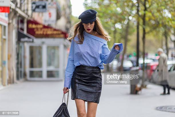 German model and fashion blogger Alexandra Lapp wearing a black skirt from HM blue Zara blouse Chanel hat Gucci shoes mules sandals and black Chanel...