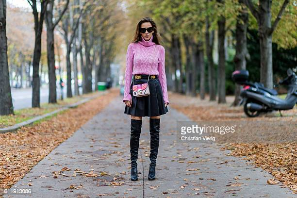 German model and fashion blogger Alexandra Lapp wearing a pink sweater from Jil Sander leather pleated skirt from Steffen Schraut overknees from...