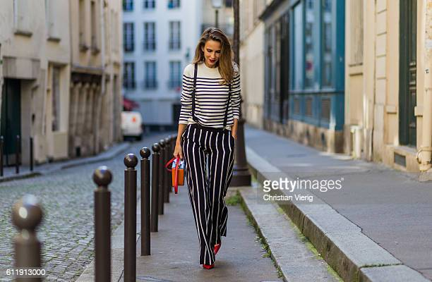 German model and fashion blogger Alexandra Lapp wearing striped jumper from Steffen Straut striped pants from Emilio Pucci suspenders HM Gianvito...