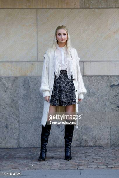 German model Anna Hiltrop wearing a half ponytail hairstyle, a long knitted cream colored cardigan by Sophie Schnoor, a white blouse with ruffles,...