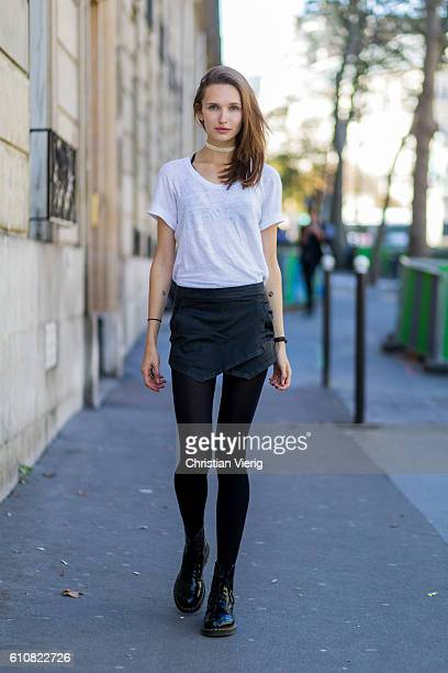 German model Anna Wliken wearing Dr Martens boots white tshirt and shorts from Zara tights on September 27 2016 in Paris France