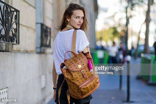 German model Anna Wliken wearing white tshirt and shorts from Zara tights and backpack from MCM on September 27 2016 in Paris France