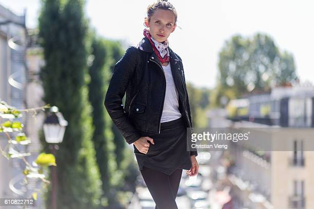 German model Anna Wliken wearing white tshirt black leather jacket and shorts from Zara tights and a scarf on September 27 2016 in Paris France