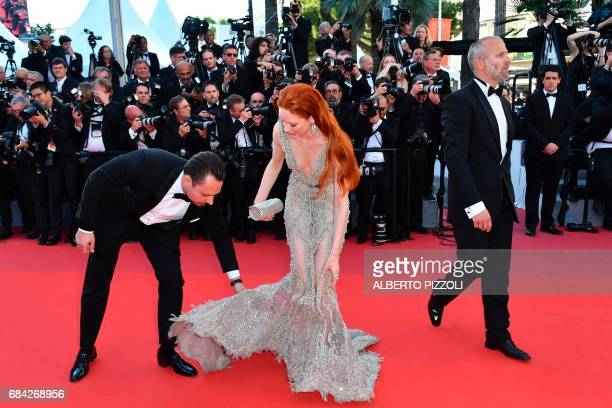 German model Barbara Meier adjusts her dress as she arrives on May 17 2017 for the screening of the film 'Ismael's Ghosts' during the opening...