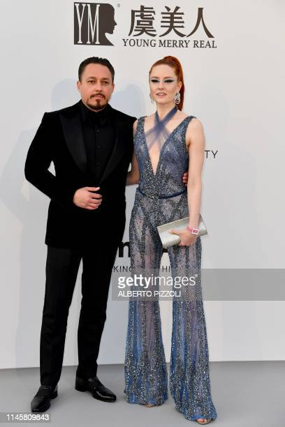 German model Barbara Meier and Austrian businessman Klemens Hallmann pose as they arrive on May 23 2019 at the amfAR 26th Annual Cinema Against AIDS...