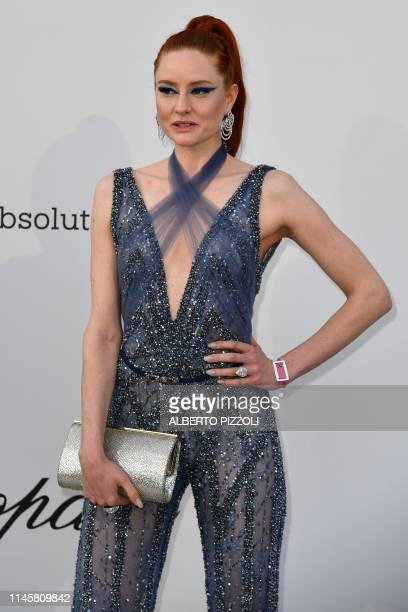 German model Barbara Meier poses as she arrives on May 23 2019 at the amfAR 26th Annual Cinema Against AIDS gala at the Hotel du CapEdenRoc in Cap...
