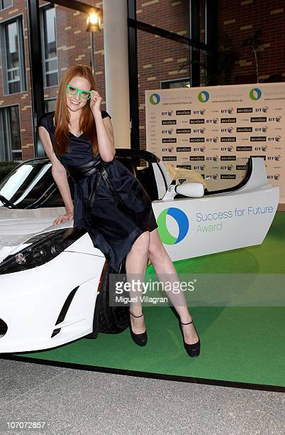 Barbara Meier poses with a giant Skechers shoe during the