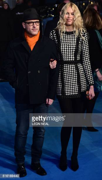 German model Claudia Schiffer and husband British director Matthew Vaughn pose for a photograph as they arrive for the European premiere of Eddie The...