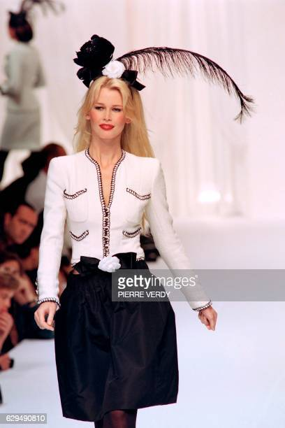German model Claudia Schiffer displays a creation designed by Karl Lagerfeld for the presentation of Chanel's 1994 FallWinter high fashion collection...