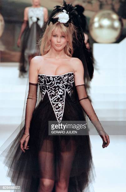 German model Claudia Schiffer displays a dress designed by Karl Lagerfeld with verses from the Koran during the presentation of Chanel's 1994...