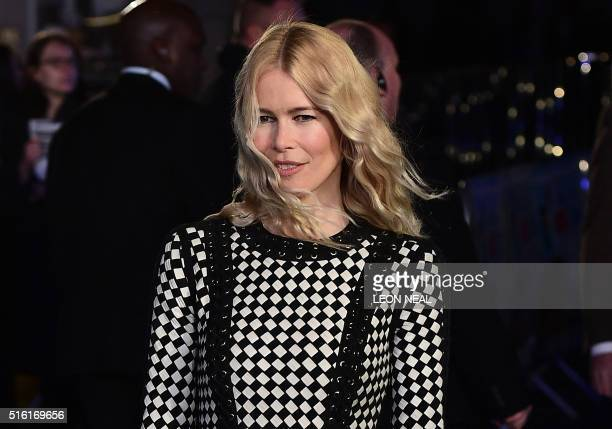 German model Claudia Schiffer poses for a photograph as she arrives for the European premiere of Eddie The Eagle in London on March 17 2016 / AFP /...