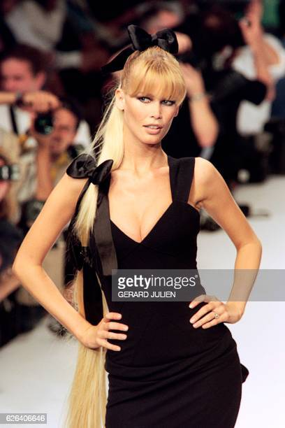 German model Claudia Schiffer shows off a creation by Karl Lagerfeld during the presentation of Chanel's FallWinter 1996 highfashion collection in...