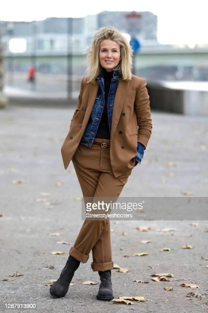 German model Elke Achmann wearing a brown blazer and matching pants by Zara, a brown belt by Gucci, a dark blue denim jeans jacket by Closed, dark...