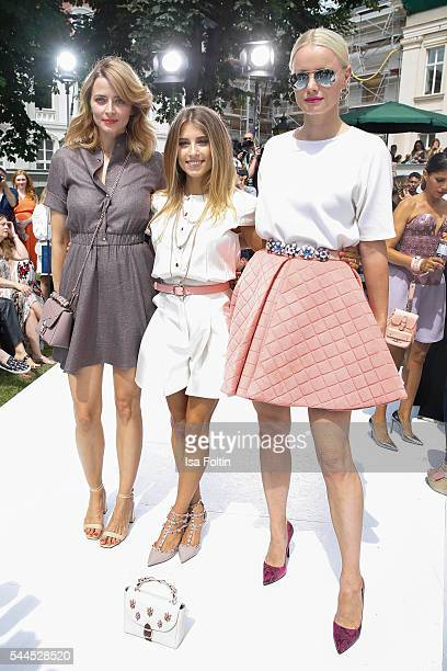 German model Eva Padberg german moderator Cathy Hummels and german model Franziska Knuppe attend the Marina Hoermanseder defilee during the Der...