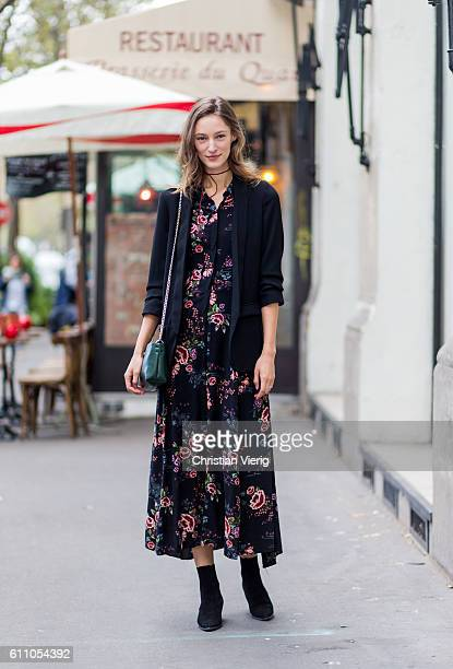 German model Franzi Mueller wearing a dress with floral print outside Lanvin on September 28 2016 in Paris France