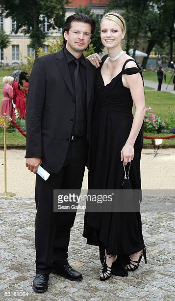 German model Franziska Knuppe and her husband Christian Moestl arrive at the Innocence in Danger Charity Gala July 1 2005 at Charlottenburg Palace in...