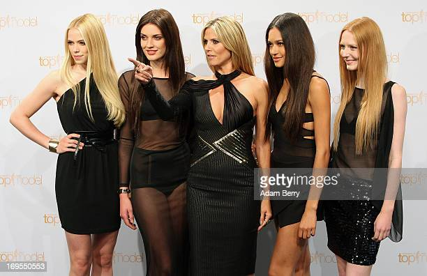 German model Heidi Klum poses with contestants Sabrina Elsner Luise Will Lovelyn Enebechi and Maike van Grieken at a photo call for the reality...