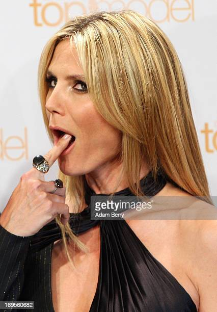 German model Heidi Klum tastes a birthday cake for her upcoming June 1 birthday at a photo call for the reality television show and modeling...