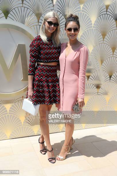 German model Lena Gercke and German actress Janina Uhse pose on May 10 2018 during a promotional event on a private beach at the 71st edition of the...