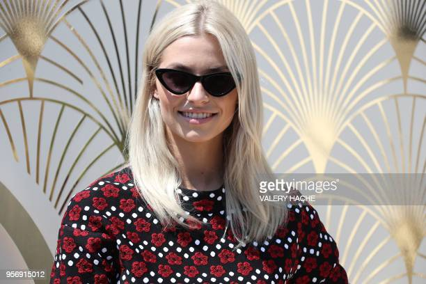 German model Lena Gercke attends on May 10 2018 a promotional event on a private beach at the 71st edition of the Cannes Film Festival in Cannes...