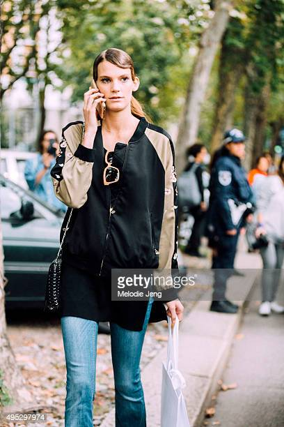 German model Lena Hardt exits the Marni show during the Milan Fashion Week Spring/Summer 16 on September 27 2015 in Milan Italy Lena checks her phone...