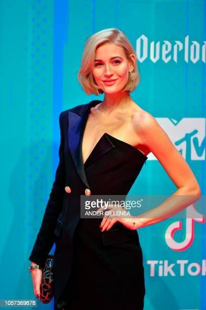 German model Mandy Bork poses on the red carpet ahead of the MTV Europe Music Awards at the Bizkaia Arena in the northern Spanish city of Bilbao on...