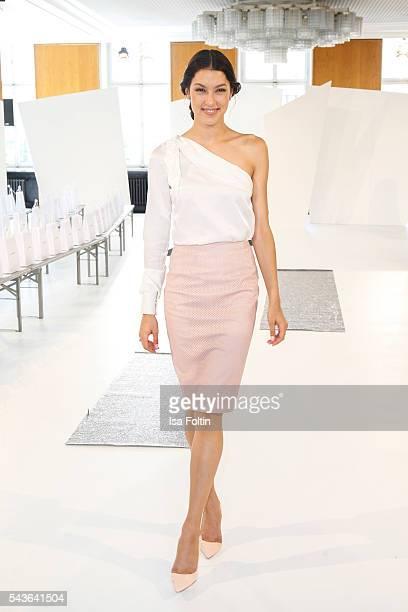 German model Rebecca Mir attends the Malaikaraiss defilee during the Der Berliner Mode Salon Spring/Summer 2017 at Kronprinzenpalais on June 28, 2016...