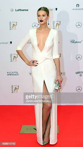 German model Toni Garrn poses as she arrives for the Bambi awards on November 13 2014 in Berlin The Bambis are the main German media awards AFP PHOTO...