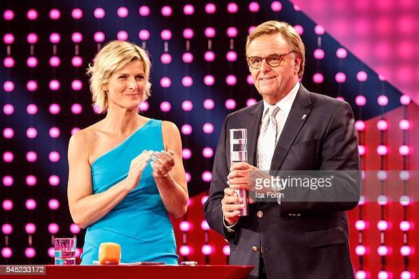 German moderator Barbara Hahlweg and award winner Roland Mack during the Deutscher Gruenderpreis on July 5, 2016 in Berlin, Germany.