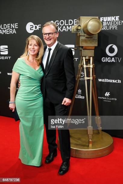 German moderator Frank Plasberg and his wife Anne Gesthuysen arrive for the Goldene Kamera on March 4 2017 in Hamburg Germany