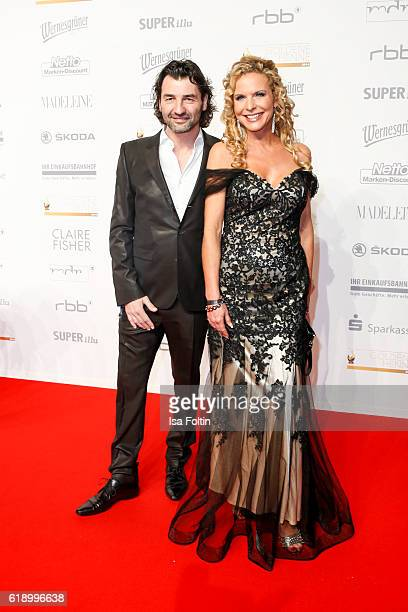 German moderator Victoria Herrmann and Uwe Schuppenhauer attend the Goldene Henne on October 28 2016 in Leipzig Germany