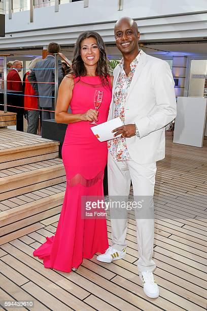 German moderator Yared Dibaba and his wife Sousa Dibada attend the Fashion2Night event at EUROPA 2 on August 23, 2016 in Hamburg, Germany.