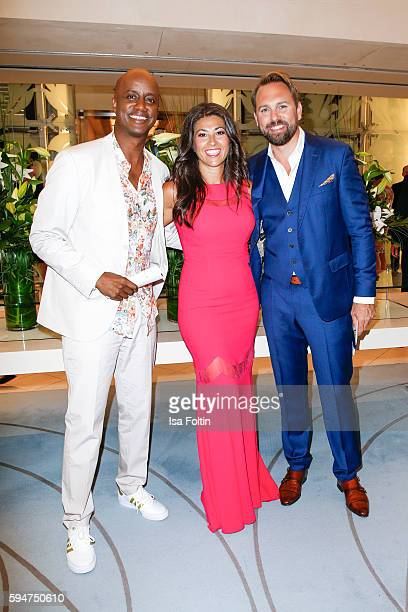 German moderator Yared Dibaba with his wife Sousa Dibaba and german moderator Steven Gaetjen attend the Fashion2Night event at EUROPA 2 on August 23,...