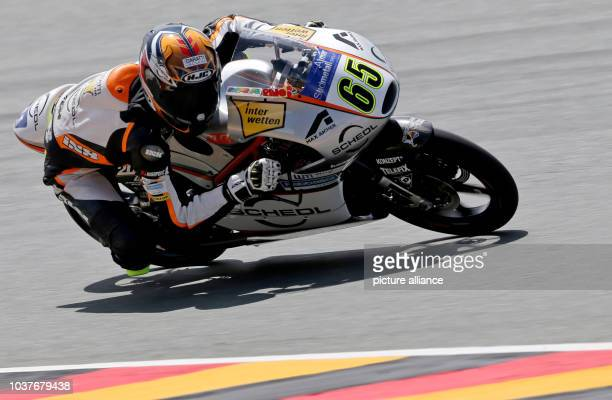 German Moto GP rider Philipp Oettl of Schedl GPTeam in action during the qualifying at the Sachsenring racing circuit in HohensteinErnstthal Germany...