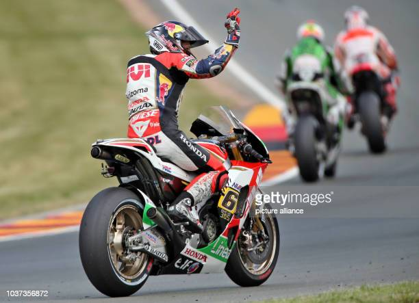 German MotoGP rider Stefan Bradl of the LCR Honda team in action during the qualifying session held at the Sachsenring race track near...