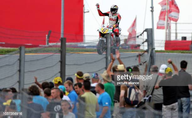 German MotoGP rider Stefan Bradl of the LCR Honda team waves after the qualifying session held at the Sachsenring race track near HohensteinErnstthal...