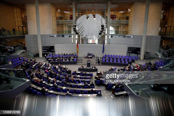 German MPs attend a session of the Bundestag on March 13 2020 in Berlin