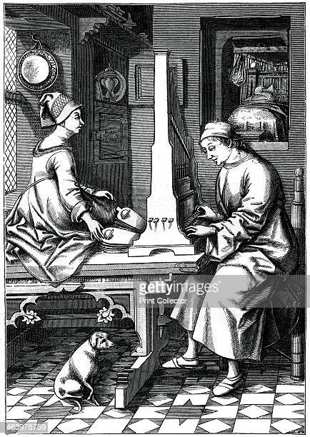 German musician executing a piece of music upon a portable organ 15th century An engraving from The Arts of the Middle Ages and at the Period of the...