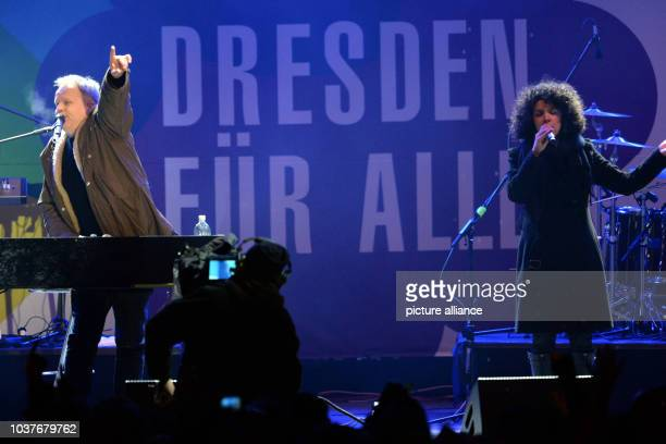 German musician Herbert Groenemeyer on stage in front of the words 'Dresden for everyone' at a concert for cosmopolitanism and tolerance at the...