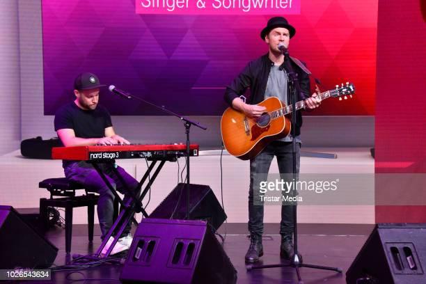 German musician Johannes Oerding performs at Telekom booth at IFA on September 3 2018 in Berlin Germany